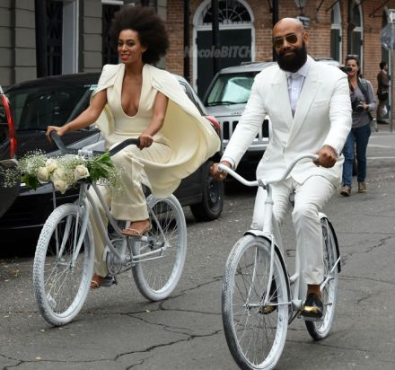 Solange-and-Alan-Ferguson-arrive-on-bikes-to-their-wedding